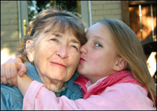Girl kissing grandmother photo